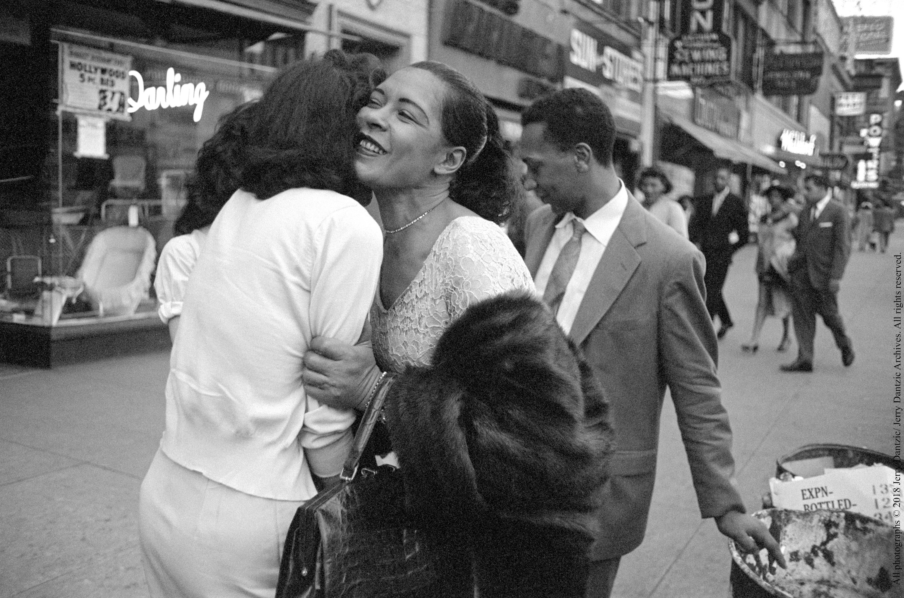 Billie Holiday embraces a fan on Broad Street after receiving a gift_Carl Drinkard is behind her flicking his cigar.jpg